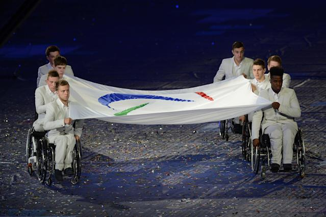 LONDON, ENGLAND - AUGUST 29: The Paralympic flag is carried by members of the Great Britain U22 Wheelchair basketball team during the Opening Ceremony of the London 2012 Paralympics at the Olympic Stadium on August 29, 2012 in London, England. (Photo by Gareth Copley/Getty Images)