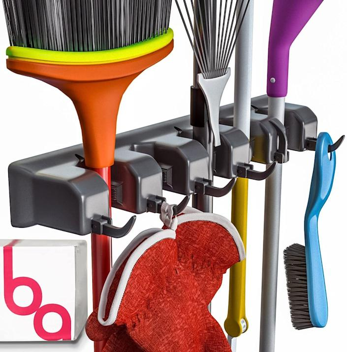 """Put this on an empty wall to keep all your cleaning tools neatly tucked away (even if you only use them once in a blue moon).<br /><br /><strong>Promising review:</strong>""""Love this broom/mop holder.<strong>So nice to save space and stay organized.</strong>Holds them so firm and flat to the wall. Also has hooks that fold out as needed. I recommend this to anyone looking for space-saving storage!"""" —<a href=""""https://www.amazon.com/dp/B01DI8H364?tag=huffpost-bfsyndication-20&ascsubtag=5834502%2C7%2C46%2Cd%2C0%2C0%2C0%2C962%3A1%3B901%3A2%3B900%3A2%3B974%3A3%3B975%3A2%3B982%3A2%2C16267136%2C0"""" target=""""_blank"""" rel=""""noopener noreferrer"""">Jaclyn</a><br /><br /><strong>Get it from Amazon for<a href=""""https://www.amazon.com/dp/B01DI8H364?tag=huffpost-bfsyndication-20&ascsubtag=5834502%2C7%2C46%2Cd%2C0%2C0%2C0%2C962%3A1%3B901%3A2%3B900%3A2%3B974%3A3%3B975%3A2%3B982%3A2%2C16267136%2C0"""" target=""""_blank"""" rel=""""noopener noreferrer"""">$14.97</a>.</strong>"""