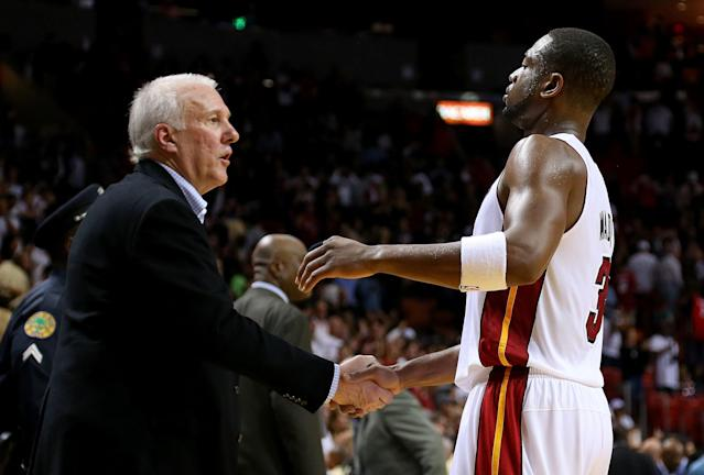 MIAMI, FL - NOVEMBER 29: Dwyane Wade #3 of the Miami Heat shakes hands with San Antonio Spurs head coach Greg Popovich during a game at American Airlines Arena on November 29, 2012 in Miami, Florida. (Photo by Mike Ehrmann/Getty Images)