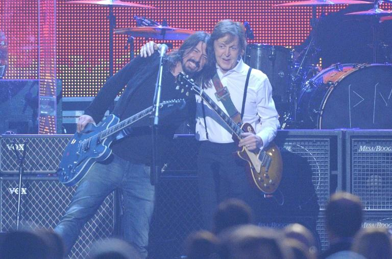 Music legend Paul McCartney (R, with Dave Grohl) as well as major music labels and film studios have lobbied politicians urging them to back the copyright changes