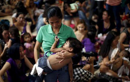 A mother breastfeeds her child in Mandaluyong