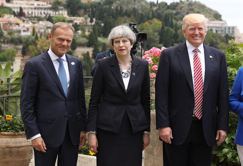 Theresa May stands between EU's Donald Tusk and US President Donald Trump at a summit in 2017