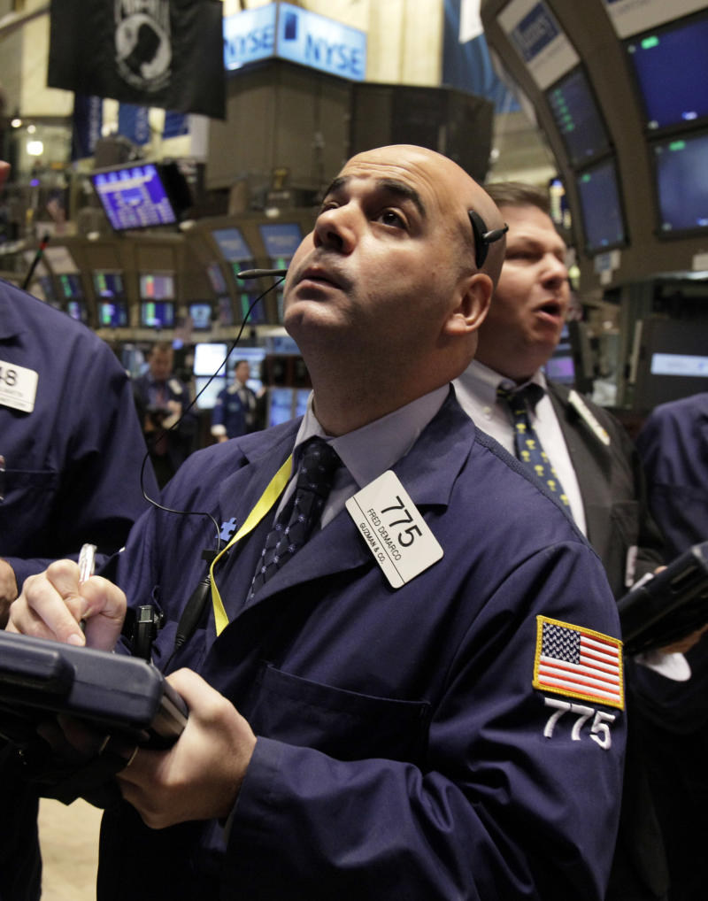 In this Nov. 3, 2010 photograph, trader Fred Demarco works on the floor of the New York Stock Exchange. (AP Photo/Richard Drew)