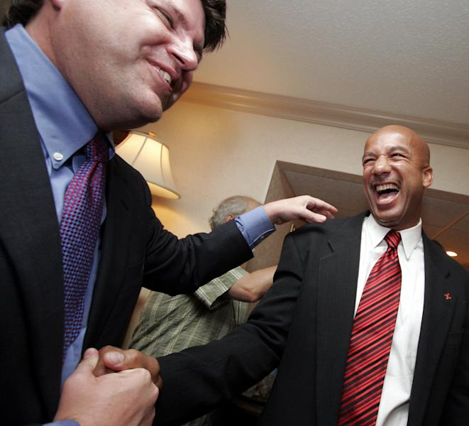 FILE - In this Saturday, May 20, 2006 file photo, New Orleans Mayor Ray Nagin, right, is greeted by the city's Chief Technology Officer Greg Meffert following his victory party in New Orleans. Nagin was indicted Friday, Jan. 18, 2013, on charges that he used his office for personal gain, accepting payoffs, free trips and gratuities from contractors while the city was struggling to recover from the devastation of Hurricane Katrina. In 2010, Meffert pleaded guilty to charges he took bribes and kickbacks in exchange for steering city contracts to a New Orleans businessman. (AP Photo/Alex Brandon, File)