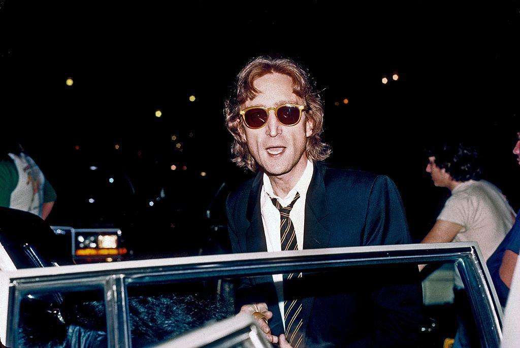 John Lennon arrives at a Times Square recording studio in August 1980 in New York City. (Photo: Vinnie Zuffante/Michael Ochs Archives/Getty Images)