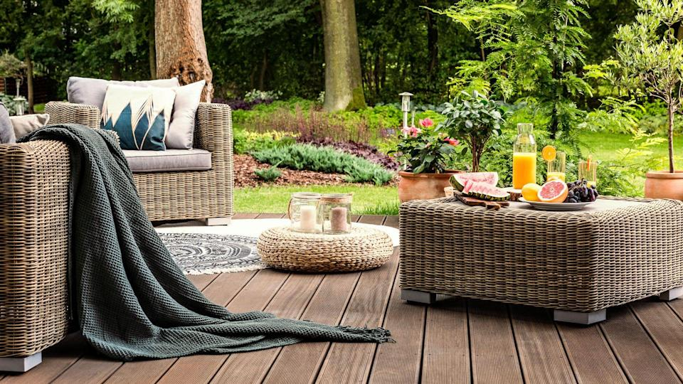 modern wooden patio with furniture in backyard