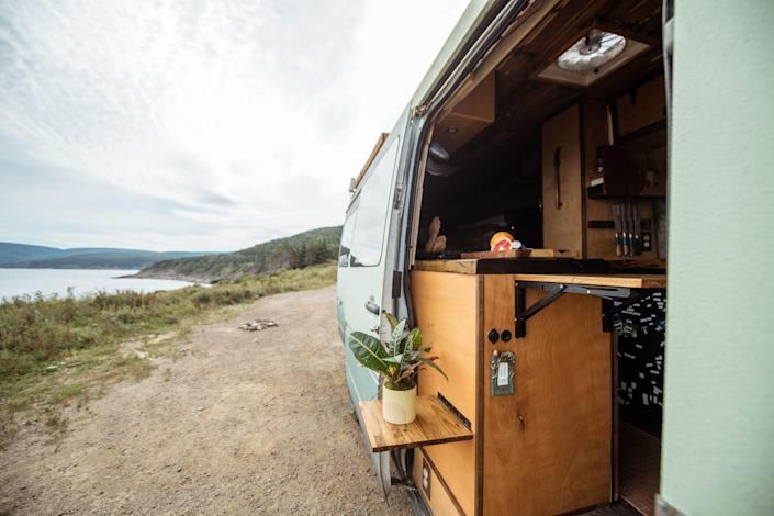 A view of the outside of the van with the door open
