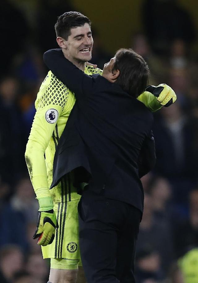 Chelsea's manager Antonio Conte (R) celebrates with goalkeeper Thibaut Courtois after their English Premier League match against Middlesbrough, at Stamford Bridge in London, on May 8, 2017 (AFP Photo/Ian Kington)