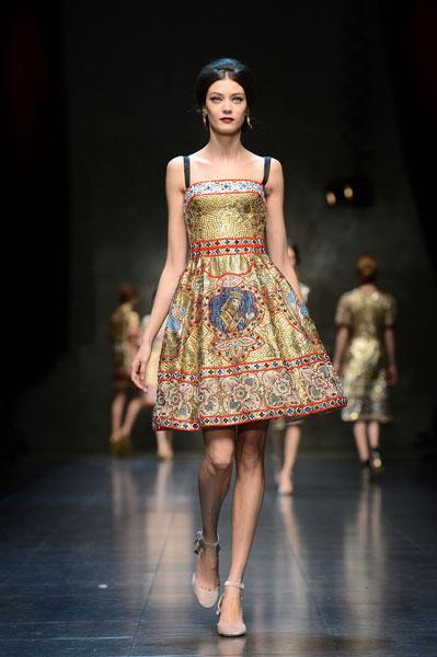 <b>Milan Fashion Week AW13: Dolce and Gabbana </b><br><br>Models wore pretty, printed dresses on the catwalk teamed with ankle-strap pumps.<br><br>© Getty