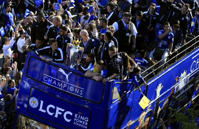 Leicester manager Claudio Ranieri, centre, clutches the Premier League trophy during an open top bus parade at the end of a fairytale 2015-16 season. The Foxes, who were almost relegated the previous year, defied odds of 5,000/1 to be crowned champions in one of the most remarkable and unlikely triumphs in the history of team sport (Tim Goode/PA)