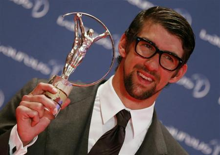 U.S. Olympic swimmer Michael Phelps poses with his Special Laureus Award during the 2013 Laureus World Sports Awards, at Municipal Theater in Rio de Janeiro