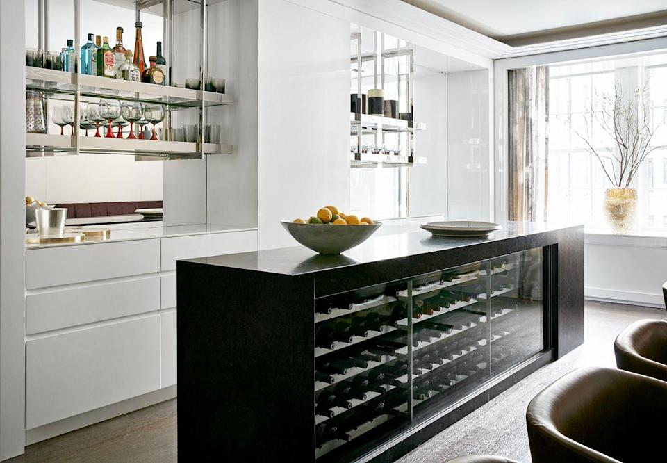 """<p>You don't need a full room to create a stylish and climate-optimized cellar. Take note of this integrated wine cooler in a kitchen island designed by <a href=""""http://www.pembrookeandives.com/"""" rel=""""nofollow noopener"""" target=""""_blank"""" data-ylk=""""slk:Pembrooke & Ives"""" class=""""link rapid-noclick-resp"""">Pembrooke & Ives</a>. </p>"""