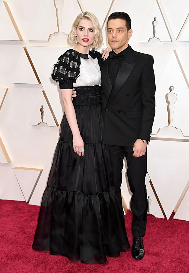 <p>Rami Malek, who picked up the Best Actor gong in 2019 for Bohemian Rhapsody and his co-star and girlfriend Lucy Boynton had couple power dressing down to a T.</p>