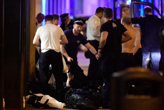 <p>Police officers get changed as they attend to an incident on London Bridge in London, Britain, June 3, 2017. (Reuters/Hannah McKay) </p>