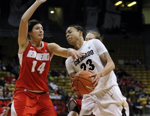 Colorado guard Chucky Jeffery, front right, drives the lane for a shot past New Mexico forward Jourdan Erskine, left, and guard Caroline Durbin, back right, in the second half of Colorado's 84-39 victory in an NCAA college basketball game in Boulder, Colo., on Saturday, Dec. 29, 2012. (AP Photo/David Zalubowski)