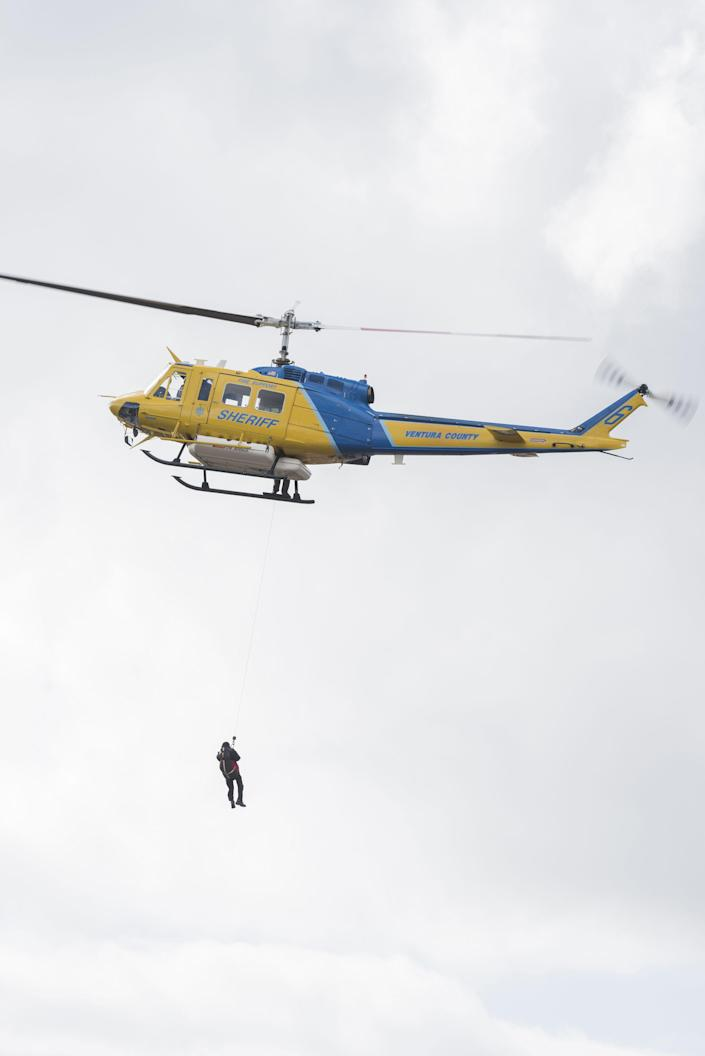 <p>A man gets rescued from the 101 freeway Tuesday afternoon. Mudslides closed the freeway down through Montecito, Calif., on Jan.9, 2018. (Photo: Erick Madrid via ZUMA Wire) </p>