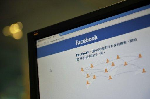 The webpage for the Chinese version of Facebook is seen on a computer screen in Hong Kong
