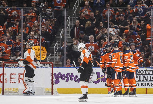Philadelphia Flyers' Andrew MacDonald (47) and his goalie Anthony Stolarz (41) look on as the Edmonton Oilers celebrate a goal during the first period of an NHL hockey game, Friday, Dec. 14, 2018 in Edmonton, Alberta. (Jason Franson/The Canadian Press via AP)