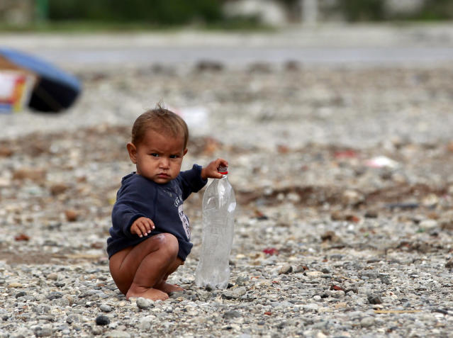 A Roma child, a refugee from Kosovo, plays with a plastic bottle at the camp Vrela Ribnicka in Podgorica, October 13, 2012. REUTERS/Marko Djurica (MONTENEGRO - Tags: SOCIETY)