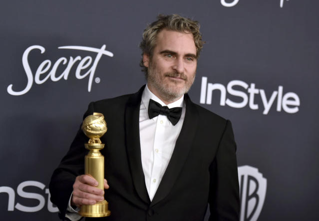 "Joaquin Phoenix, winner of the award for best performance by an actor in a motion picture drama for ""Joker"", arrives at the InStyle and Warner Bros. Golden Globes afterparty at the Beverly Hilton Hotel on Sunday, Jan. 5, 2020, in Beverly Hills, Calif. (Richard Shotwell/Invision/AP)"