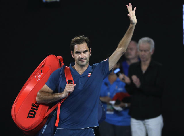 Switzerland's Roger Federer waves as he leaves Rod Laver Arena after losing his fourth round match against Greece's Stefanos Tsitsipas at the Australian Open tennis championships in Melbourne, Australia, Sunday, Jan. 20, 2019. (AP Photo/Mark Schiefelbein)