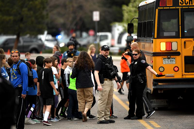 HIGHLANDS RANCH, CO - MAY 7: Officers and teachers evacuating students after a shooting at the STEM School Highlands Ranch on May 7, 2019, in Highlands Ranch, Colorado. (Photo by Joe Amon/MediaNews Group/The Denver Post via Getty Images)