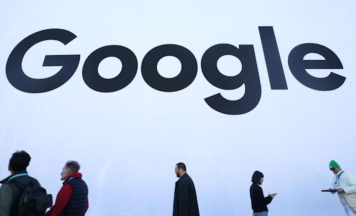 People walk past the Google pavilion at CES 2020 at the Las Vegas Convention Center on January 8, 2020 in Las Vegas, Nevada. (Photo by Mario Tama/Getty Images)
