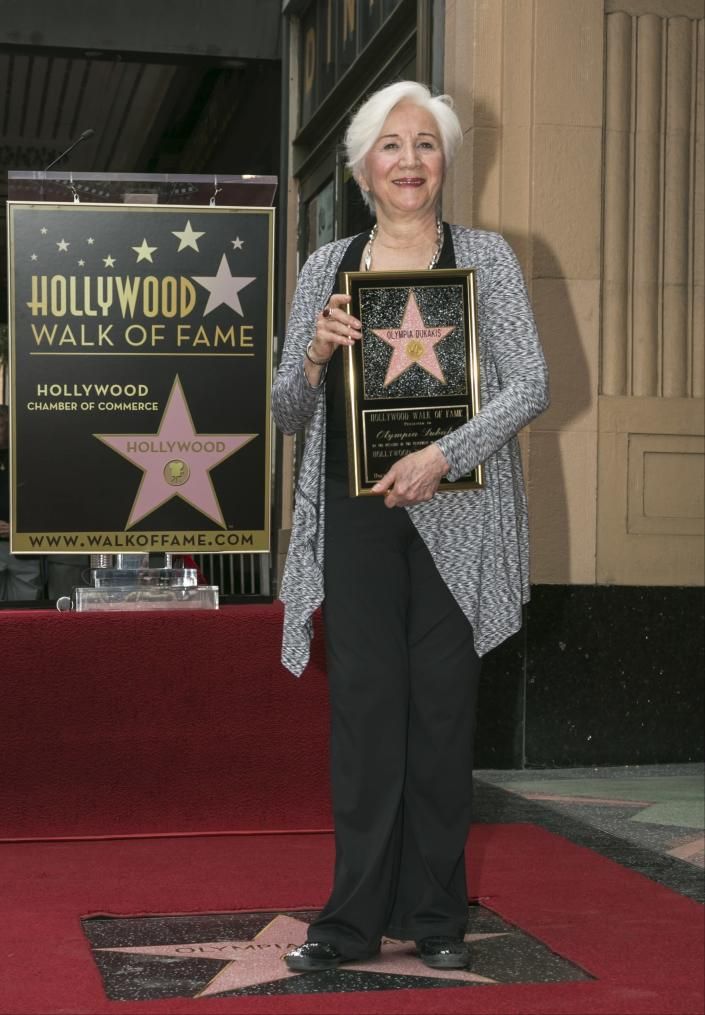 """FILE - In this May 24, 2013 file photo, Actress Olympia Dukakis is honored with a star on the Hollywood Walk of Fame for her stage work in front of the Pantages Theatre in Los Angeles. Olympia Dukakis, the veteran stage and screen actress whose flair for maternal roles helped her win an Oscar as Cher's mother in the romantic comedy """"Moonstruck,"""" has died. She was 89. (AP Photo/Damian Dovarganes, File)"""