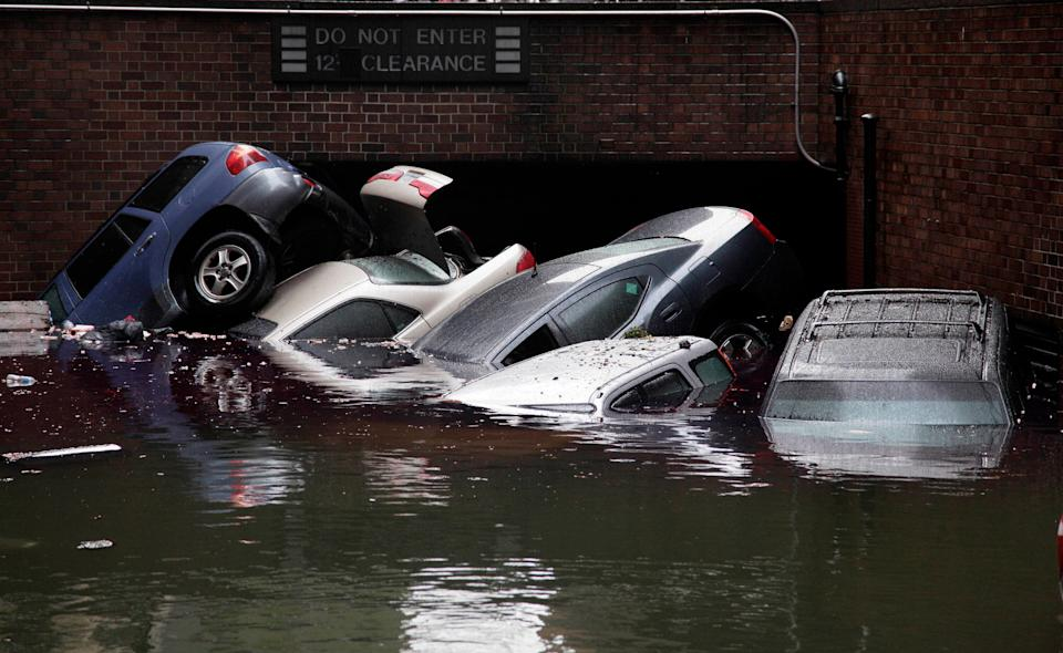 Cars are submerged at the entrance to a parking garage in New York's Financial District in the aftermath of Superstorm Sandy on Oct. 29, 2012. (Photo: Richard Drew/AP)