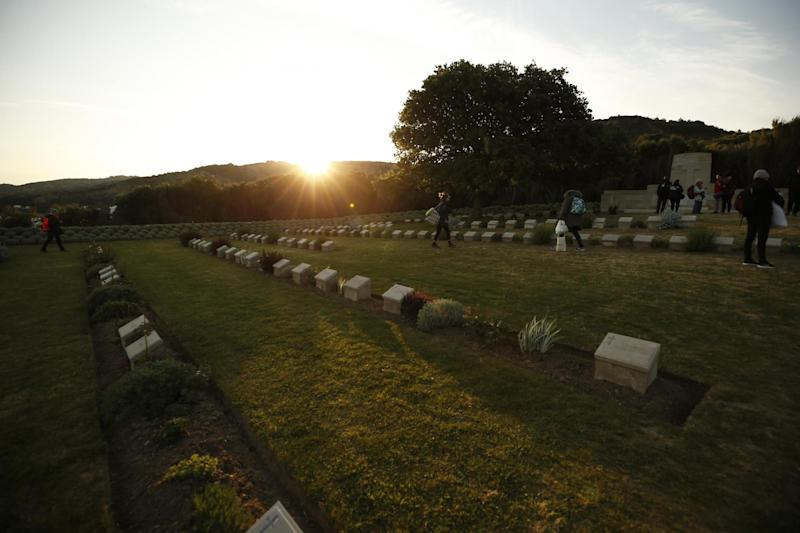 Dawn: people walk at the Anzac Cove cemetery by the site, in Gallipoli peninsula, Turkey (AP)