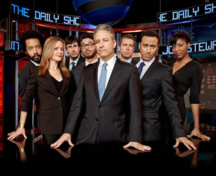 "This undated image released by Comedy Central shows, from left, Wyatt Cenac, Samantha Bee, John Oliver, Al Madrigal, Jon Stewart, Jason Jones, Aasif Mandvi and Jessica Williams from ""The Daily Show with Jon Stewart."" The popular political satire show will be covering the Republican National Convention this week and will shift its regular schedule a day to broadcast four shows from Tampa Tuesday through Friday. (AP Photo/Comedy Central, Martin Crook)"