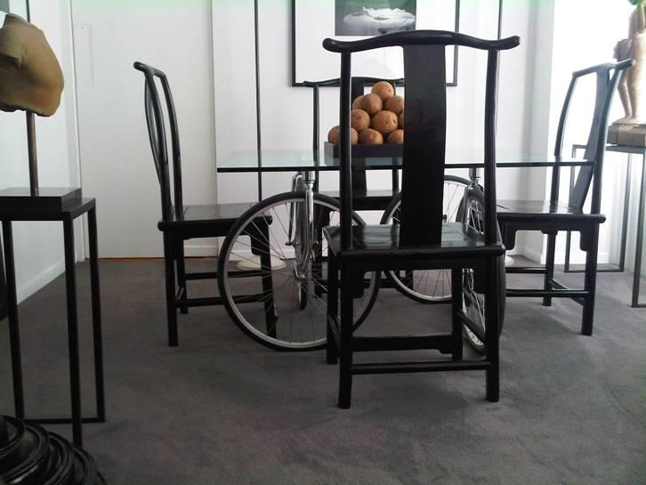This undated photo provided by GCK Partners shows a table with bicycle wheels as legs. There's often the touch that gives Terron Schaefer, Saks Fifth Avenue chief creative officer, a conversation piece: It could be a bright pocket square or cool tie for his outfit. In his dining area, it's an unfussy table _ with bicycle wheels as legs. (AP Photo/GCK Partners, Terron Schaefer, HO)
