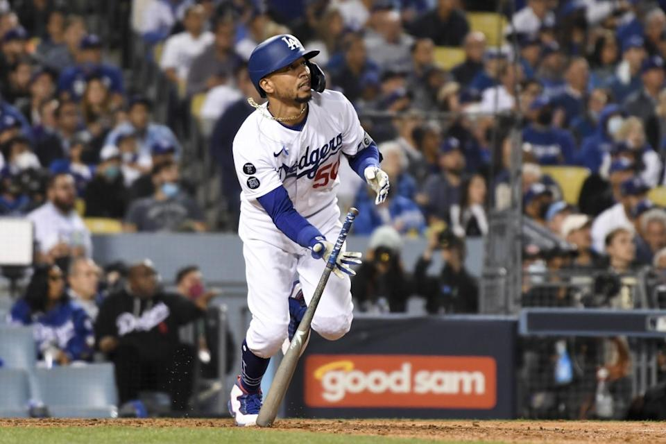 Mookie Betts tosses his bat after hitting a two-run home run for the Dodgers in the fourth inning.