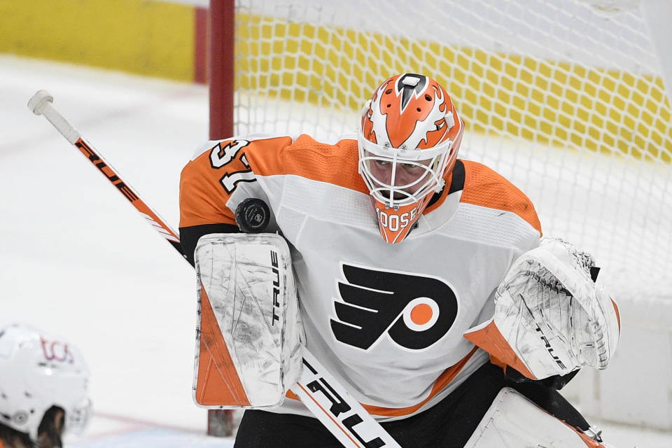 Philadelphia Flyers goaltender Brian Elliott (37) stops the puck during the second period against the Washington Capitals in an NHL hockey game Tuesday, April 13, 2021, in Washington. (AP Photo/Nick Wass)