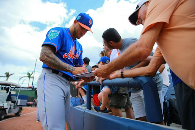 <p>New York Mets minor league pitcher Tyler Bashlor signs for fans before the baseball game against the Houston Astros at the Ballpark of the Palm Beaches in West Palm Beach, Fla., on Feb. 26, 2018. (Photo: Gordon Donovan/Yahoo News) </p>