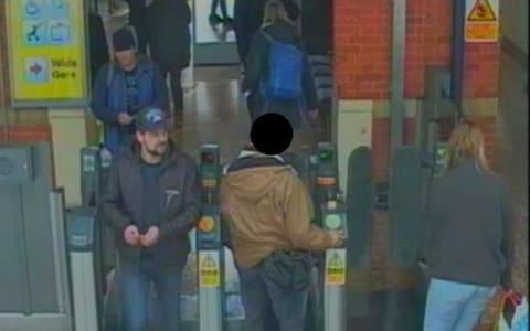 Both suspects, left, prepare to board a train in Salisbury - Credit: Metropolitan Police