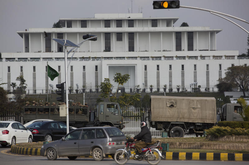 Pakistan army trucks park outside a presidential palace as security is beefs up in Islamabad, Pakistan, Friday, Feb. 15, 2019. Pakistan said that Crown Prince Mohammed bin Salman will arrive in Islamabad later this week on an official visit that is expected to include the signing of agreements for billions of dollars of investment in Pakistan. (AP Photo/B.K. Bangash)