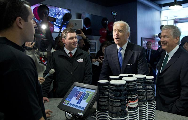 Vice President Joe Biden looks up at the menu board as he buys lunch at Capriotti's Sandwich Shop, Thursday, Nov. 21, 2013, in Washington. Biden is a frequent costumer of Capriotti's in Delaware. This is Capriotti's first store in Washington. (AP Photo/Carolyn Kaster)