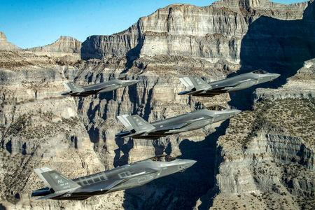 FILE PHOTO:A formation of U.S. Air Force F-35 Lightning II fighter jets perform aerial maneuvers during as part of a combat power exercise over Utah Test and Training Range, Utah, U.S. November 19, 2018.  U.S. Air Force/Staff Sgt. Cory D. Payne/Handout via REUTERS