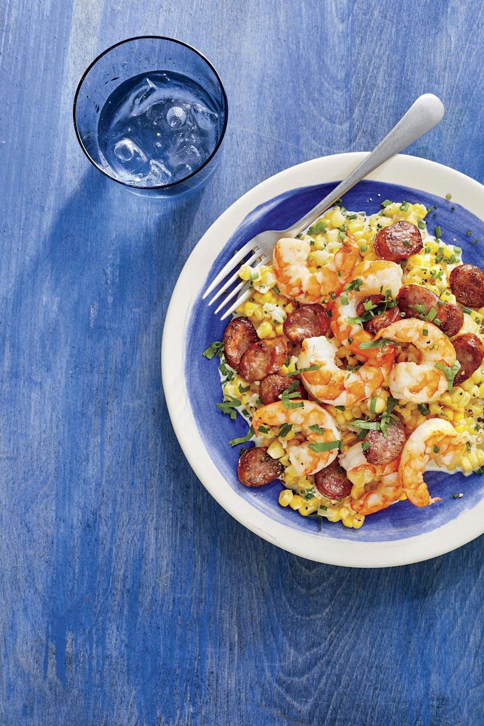 "<p><strong>Recipe: </strong><a href=""https://www.southernliving.com/recipes/skillet-corn-shrimp-sausage"" rel=""nofollow noopener"" target=""_blank"" data-ylk=""slk:Skillet Corn with Shrimp and Sausage"" class=""link rapid-noclick-resp""><strong>Skillet Corn with Shrimp and Sausage</strong></a></p> <p>This skillet recipe was so popular because it satisfies everything you could need in a weeknight dinner recipe: one dish, only 30 minutes of time, and fresh ingredients. Our readers found fun ways to mix it up using whatever fresh veggies or proteins they had on hand. </p>"