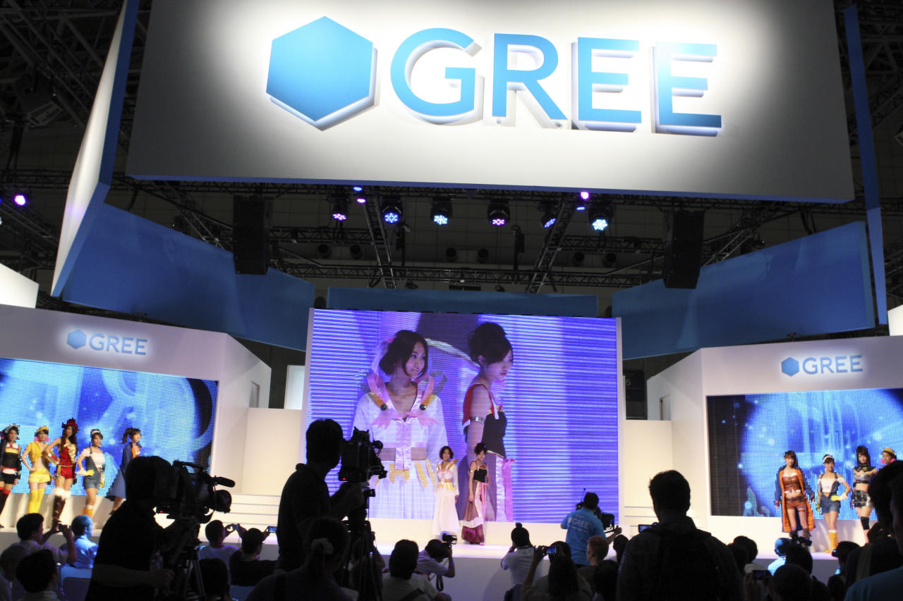 Staff members promote at a booth for social networking service Gree Inc. at the Tokyo Game Show in Chiba, east of Tokyo, Thursday, Sept. 15, 2011. A startup little known outside Japan that offers games for cellphones is emerging as the new star at this year's Tokyo video game exhibition, usually dominated by big-name console makers like Sony and Microsoft. Gree, that began just seven years ago in the founder's living room, had its first booth ever at the sprawling Tokyo Game Show, which previewed to media Thursday ahead of its opening to the public later this week. (AP Photo/Koji Sasahara)