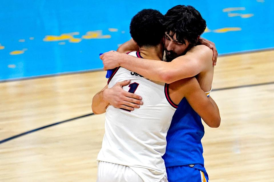Gonzaga Bulldogs guard Jalen Suggs (1) greets UCLA Bruins guard Jaime Jaquez Jr. (4) after their game in the national semifinals of the Final Four of the 2021 NCAA Tournament at Lucas Oil Stadium.