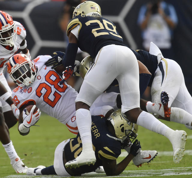 Clemson running back Tavien Feaster (28) is hit by Georgia Tech defensive back Tariq Carpenter (29) during the first half of an NCAA college football game, Saturday, Sept. 22, 2018, in Atlanta. (AP Photo/Mike Stewart)
