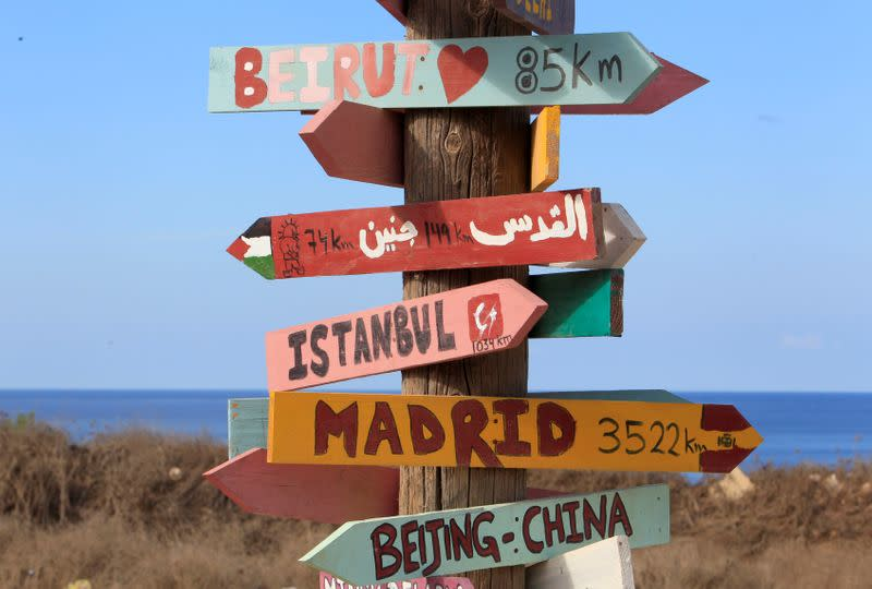 FILE PHOTO: Signs bearing names of cities are pictured in Naqoura