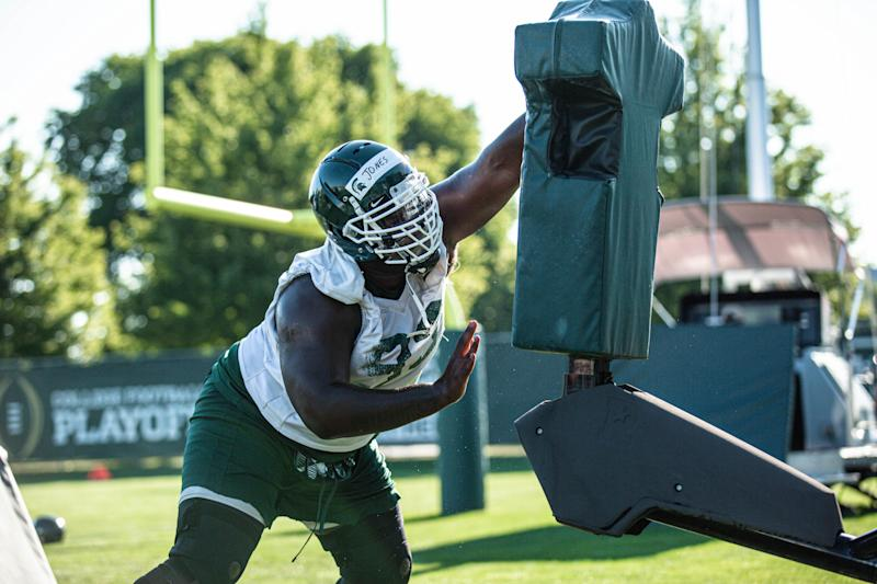 Michigan State senior defensive tackle Naquan Jones goes through drills during practice in August.