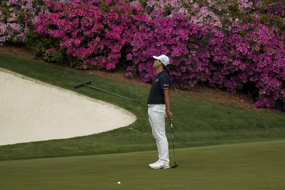 CORRECTS SPELLING OF NAME TO SI, NOT IS - Si Woo Kim, of South Korea, reacts after missing an eagle putt on the 13th green during the second round of the Masters golf tournament on Friday, April 9, 2021, in Augusta, Ga. (AP Photo/David J. Phillip)
