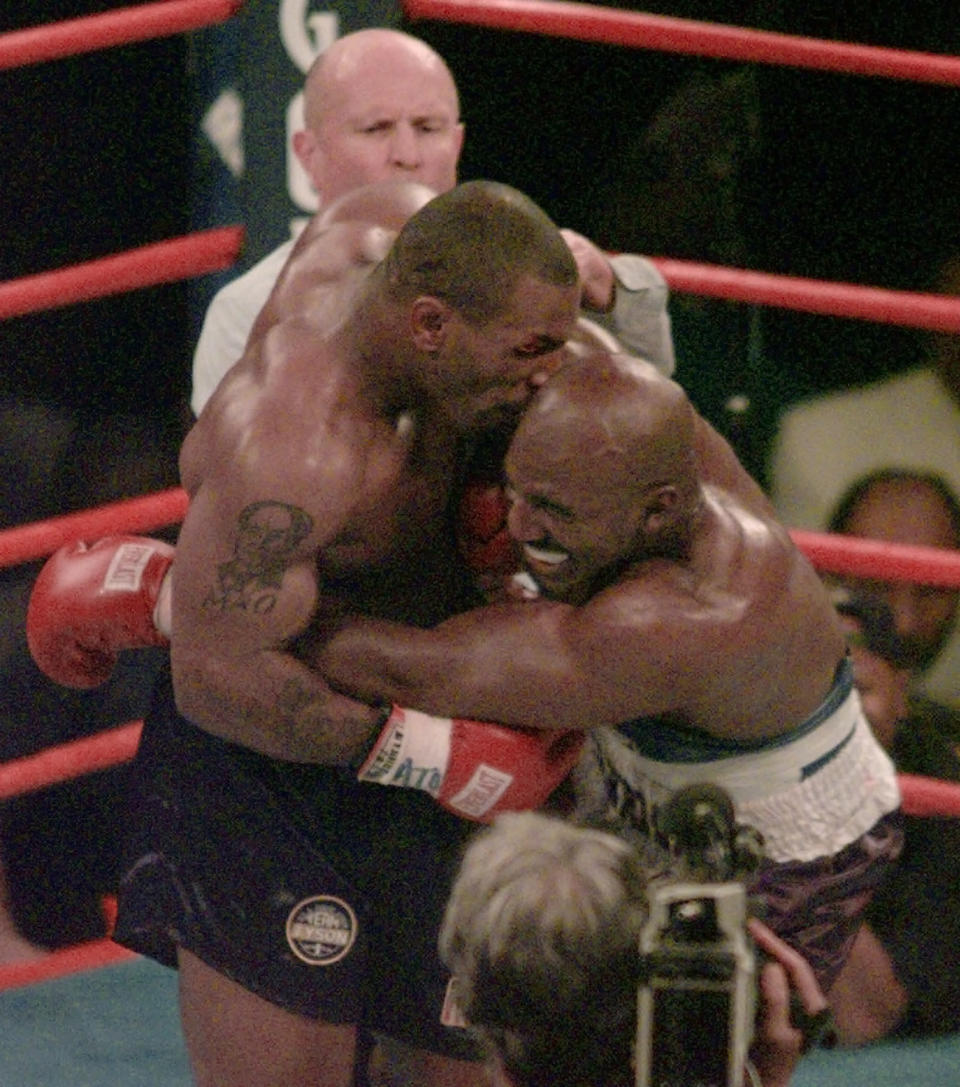 <p>Mike Tyson, left, bites into the ear of Evander Holyfield in the third round of their WBA Heavyweight match at the MGM Grand in Las Vegas. (AP Photo/Jack Smith, File) </p>