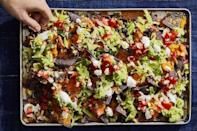 """<p>Make your nachos better than the rest with this sheet-pan option that's loaded with black beans, cheese, sour cream, lettuce, pico de gallo, and whatever else you can think of. </p><p><em><a href=""""https://www.goodhousekeeping.com/food-recipes/a29960234/how-to-make-nachos-recipe/"""" rel=""""nofollow noopener"""" target=""""_blank"""" data-ylk=""""slk:Get the recipe for Game Day Nachos »"""" class=""""link rapid-noclick-resp"""">Get the recipe for Game Day Nachos »</a></em></p>"""