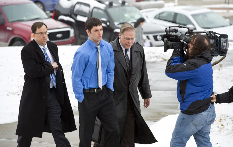 Matthew Barnett walks into the courthouse with his legal counsel David Bell, left, and J.R. Hobbs for a hearing on Thursday, Jan. 9, 2014 in Maryville, Mo. Barnett is accused of sexually assaulting a 14-year-old schoolmate when he was 17 has been charged with misdemeanor child endangerment. Special prosecutor Jean Peters Baker has been re-examining the girl's allegations that Barnett raped her at a January 2012 house party, when he was a Maryville High School senior and she was a freshman. (AP Photo/The Kansas City Star, The Kansas City Star) KANSAS CITY OUT