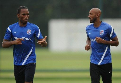 Shanghai Shenhua players Didier Drogba (L) and Nicolas Anelka during a team training session in Shanghai on July 16. The match on Sunday was notable for being the first time Drogba and Anelka have played together at Shenhua